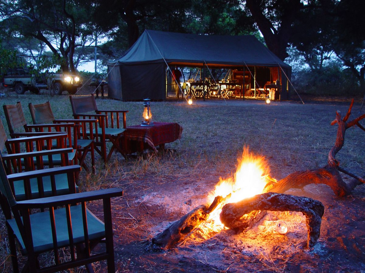 Fireside relaxation at Chada Katavi Camp, Katavi National Park, Tanzania © Nomad Tanzania
